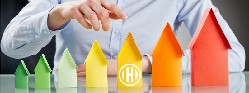 paper houses with Hogan Associates logo
